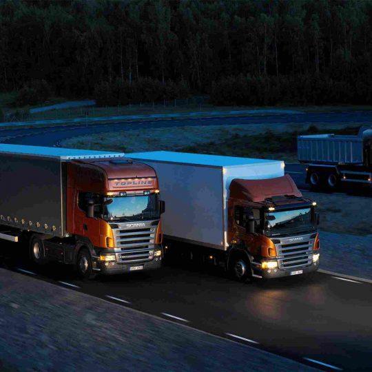 http://atlantis-zollspedition.de/wp-content/uploads/2015/09/Three-orange-Scania-trucks-540x540.jpg